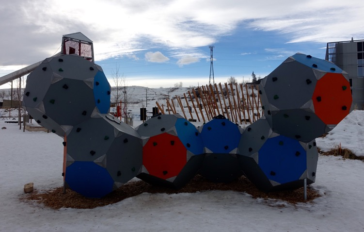 """This climbing object is full of climbing """"holds."""" It is very sculptural and can be used by kids of all ages, as well as adults."""