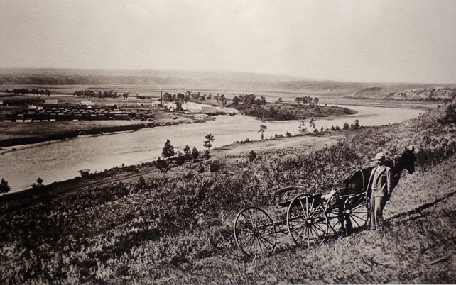 Bow River (Makhabn River)looking west with Prince's Island and Eau Claire lumber mill in the distance. This photo is from the current exhibition at the Lougheed House.