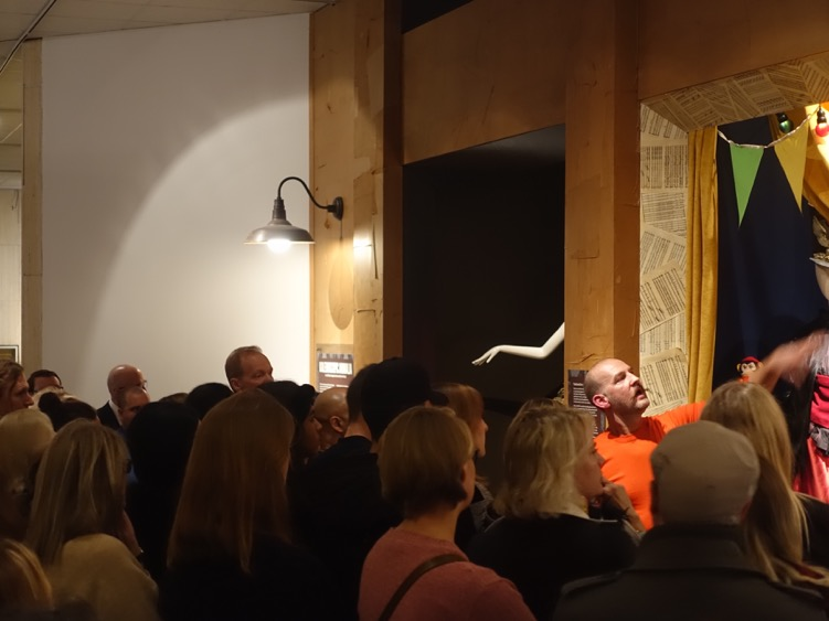 """Hardy gives a passionate tour to group of very attentive Glenbow visitors on """"Free First Thursday"""" night."""
