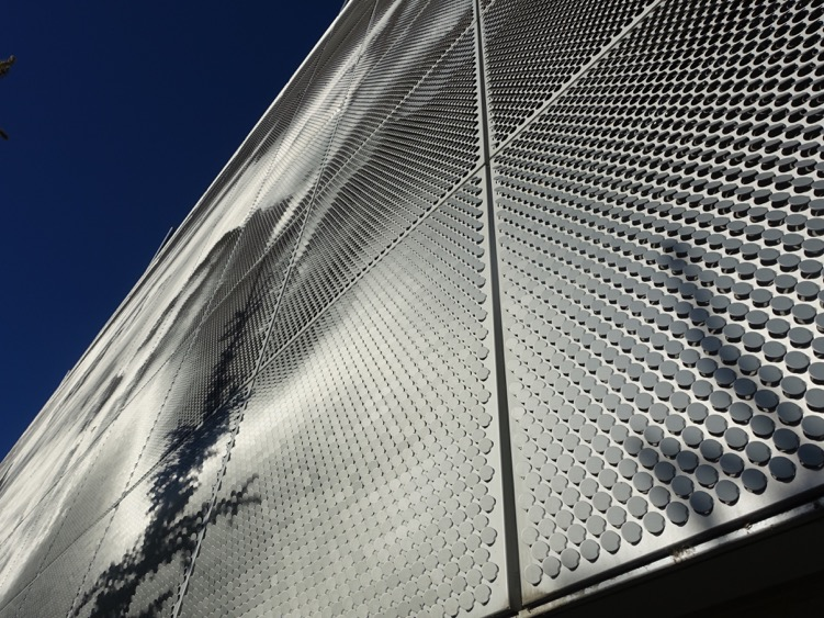 This is the stunning, shimmering, facade of the SAIT Parkade that from a distance becomes a huge artwork.