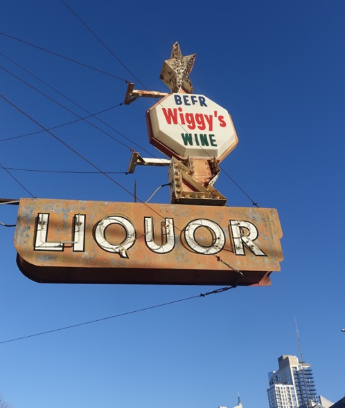 Established in 1973, the Wiggly Beer Wine neon sign marks the entrance to a tiny liquor store at the gateway to downtown along 6th Street West.