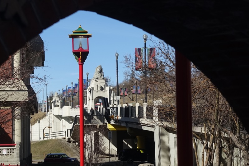 Archway to Chinese Seniors Centre provides a wonderful vista of the Centre Street Bridge and its iconic lions.