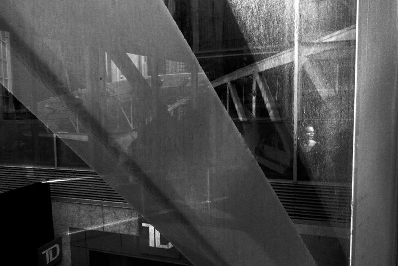 I had no idea I had captured this woman in this photo when I took it. At the time I was cursing that the windows were dirty and I couldn't get clean reflections. Now I love the ambiguity of the narrative that this image suggests. Urban surprises come in many different ways.