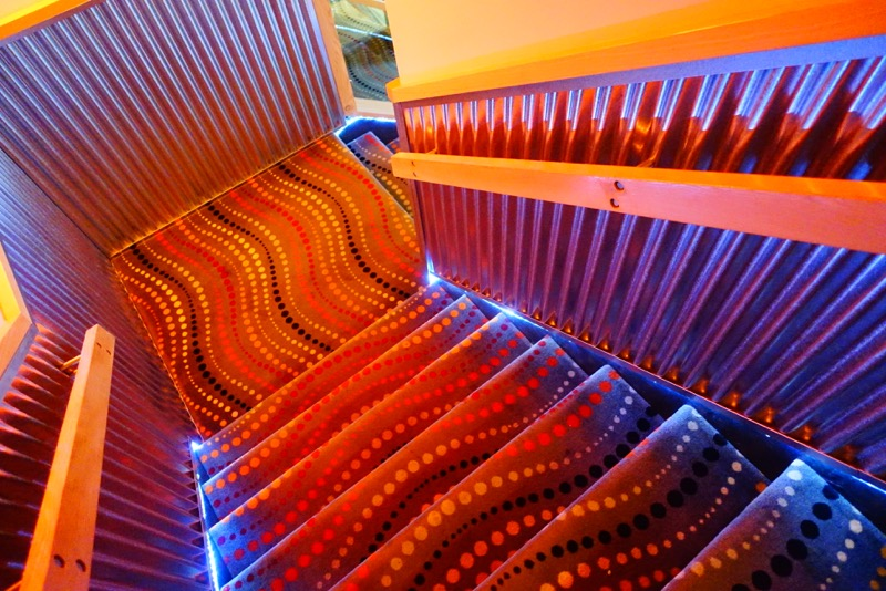 The staircase at the Adventure Hotel is like walking on a neon sign.