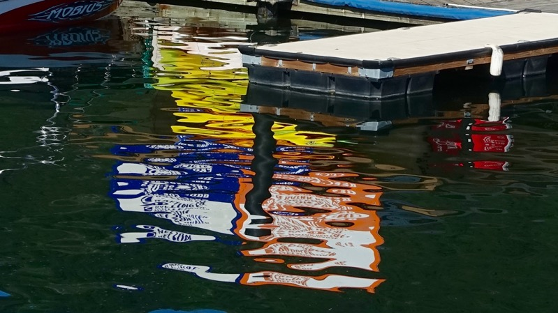 One of the many lovely reflections of the boats in the water along the pathway.