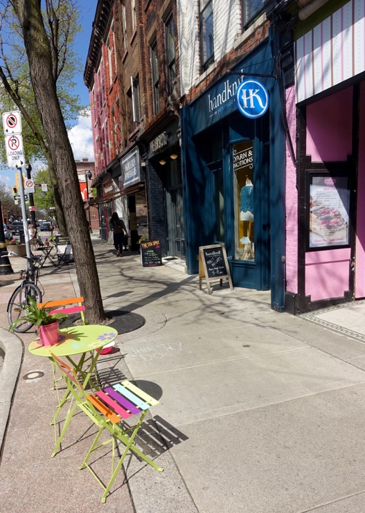 Colourful storefronts and street adornment create a funky hip pedestrian experience along James Street North.
