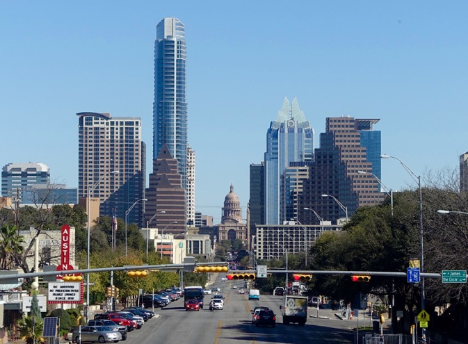 A view of downtown Austin from South Congress aka SoCo.  SoCo is a an eclectic pedestrian street (despite being a major road) with shops, restaurants, music venues, great patios and numerous permanent food trucks on empty lots.
