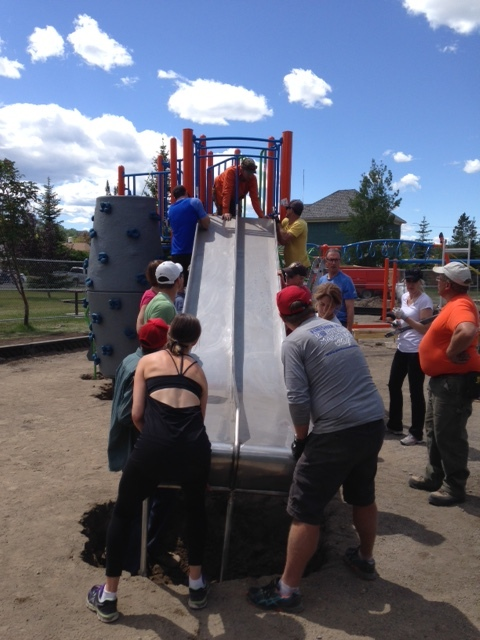 Even with all of our team work, the 8ft slide wouldn't attach to the 7ft climbing wall structure.