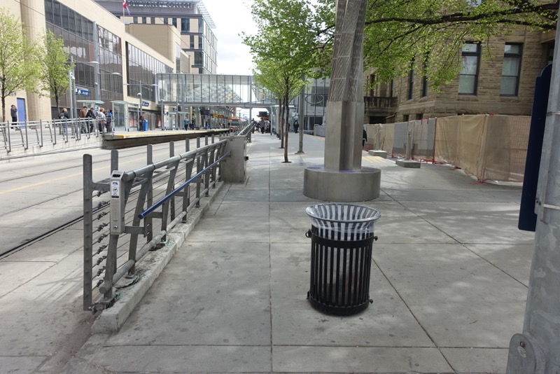 The new design 7th Avenue is not pedestrian friendly as the sidewalk an obstacle course of garbage cans, artwork, trees, posts and fences.