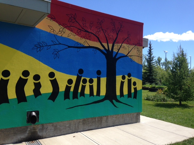 This mural on the side of the Banff Trail Community Centre intrigued me to wander up for a closer look which is when I discovered their lovely community garden complete with an orchard.