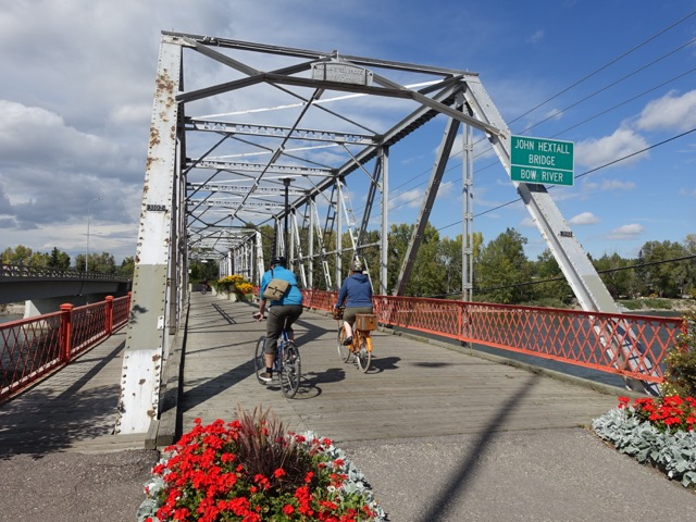 The bridge has colourful flowers at each entrance and huge planter boxes in the middel of the bridge.  Cyclist and pedestrians share the space with ease.