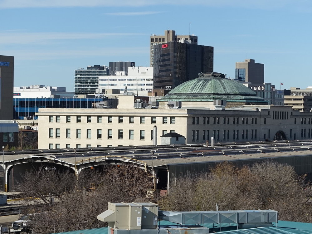 Winnipeg's Union Station and railway sheds separate The Forks from downtown.