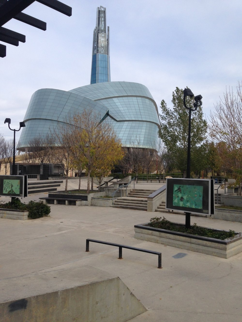 The uniquely shaped Human Rights Museum dominates The Forks. In the foreground is a multi-purpose plaza that can serve as a skatepark, busker/performance space or casual sitting area.