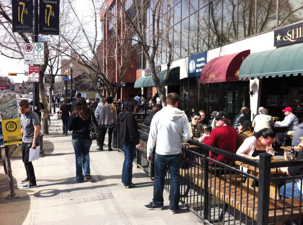 Calgary's 17th Avenue is often bustling with pedestrians and patio patrons on a sunny day in the winter.