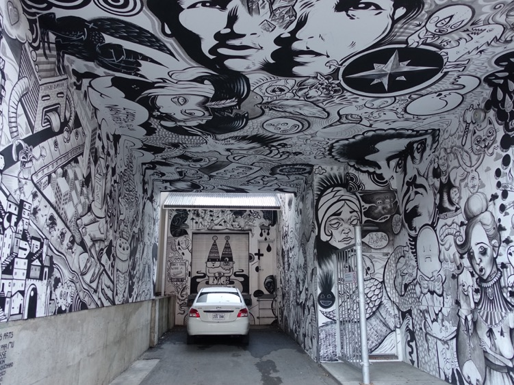 You have to admit this is fun, funky and quirky.  Found this black and white carport artwork while wandering along Boulevard St. Laurent aka The Main (because it is Main Street and divides the city into east and west). The Main is full of fun murals in the alleys and on the side of buildings at street corners.  It makes this street a fun place to flaneur. You can find this garage at 4866 St. Laurent.