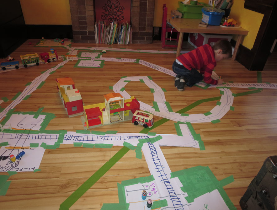 Alec started young creating his own transit systems. Hey we both have that Fisher Price school bus.