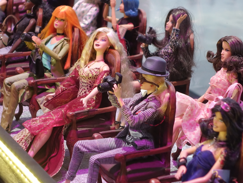 In the underground of the Les Cours Mont-Royal building is the world's largest collection of Barbie Dolls - over 1,000.  How playful is that? Click  here  for more info