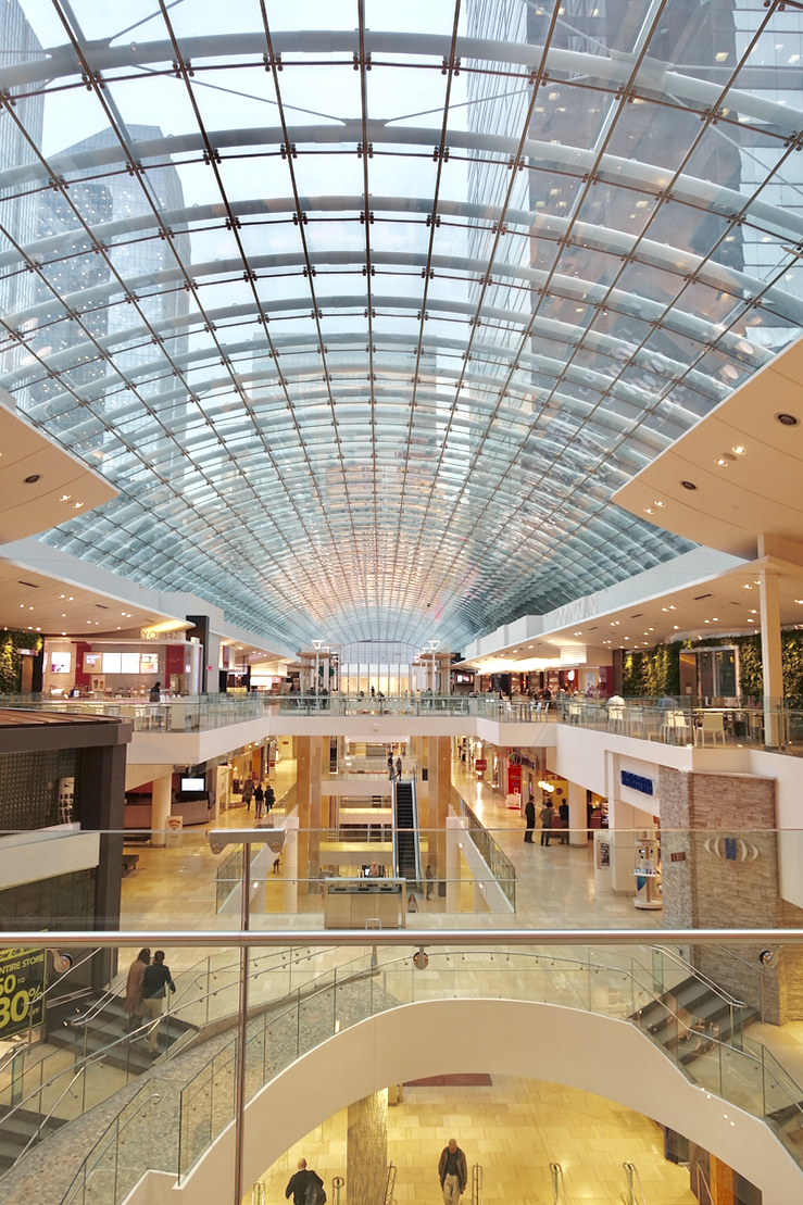 Calgary's The Core shopping centre is three blocks long with a huge glass skylight, creating an contiguous shopping experience, with sky bridges at both the second and third floors. Yes, there are some stairs and ramps to negotiate.