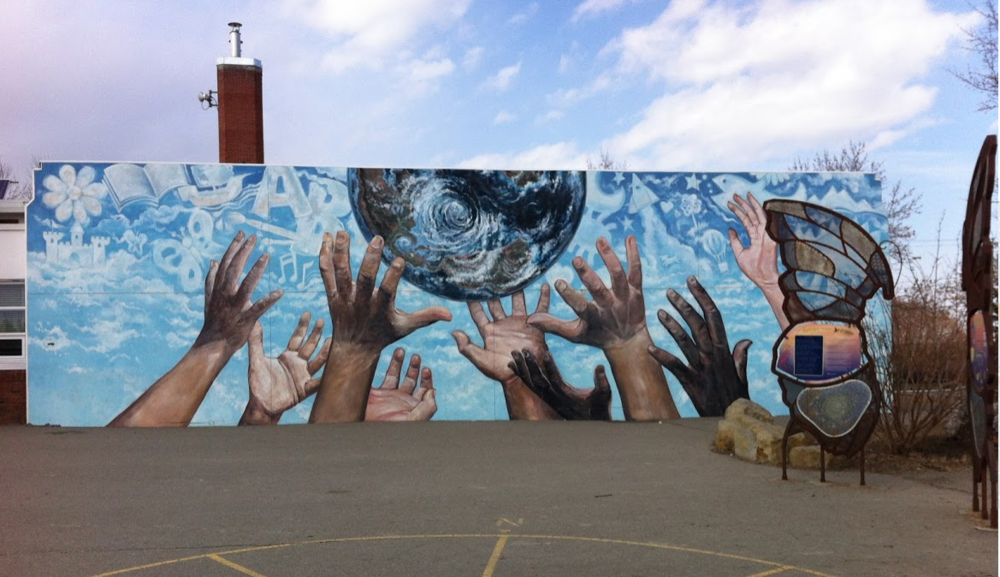 """The Promise"" dominates the Alex Ferguson's schoolyard. Visible from 17th Ave SW at 26th Street."