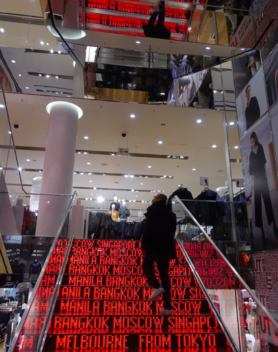 Japanese retailer UNIQLO's flagship store in Berlin has wonderful stairs, which have the names of cities in neon red streaming across them like a stock market quotation board.
