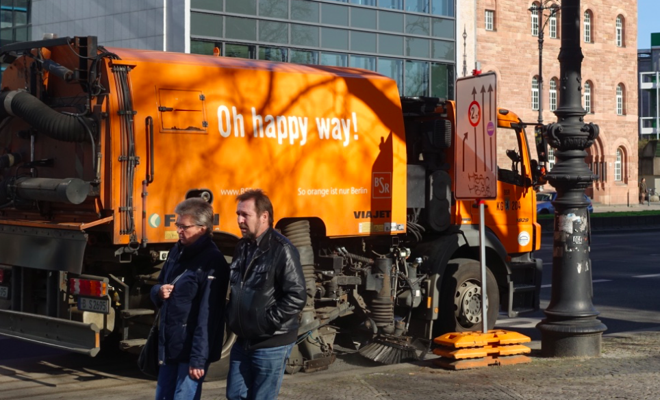 "The orange ""Oh happy way!"" street sweepers say it all...."