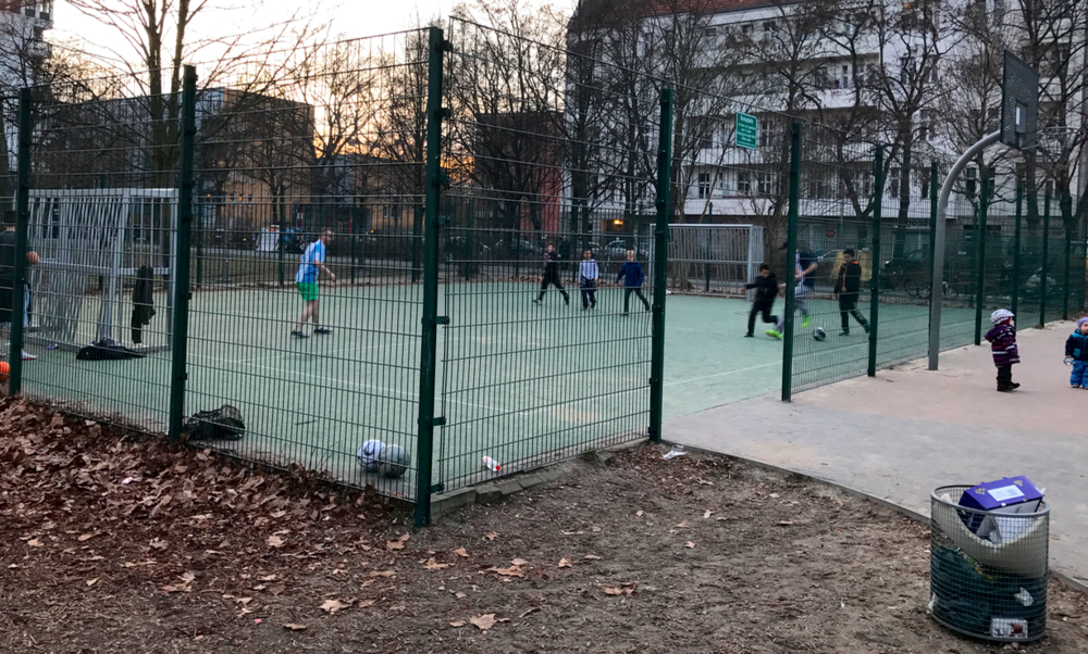 An example of a caged court for playing soccer with a basketball court next to it.