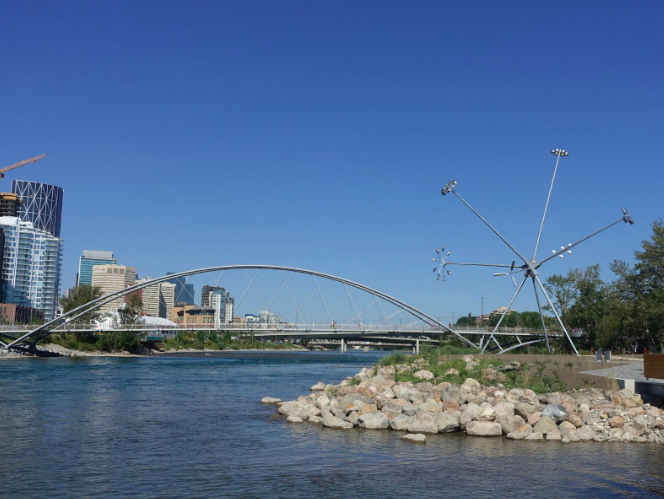 King Bridge over the Bow River with Bloom artwork on the right.