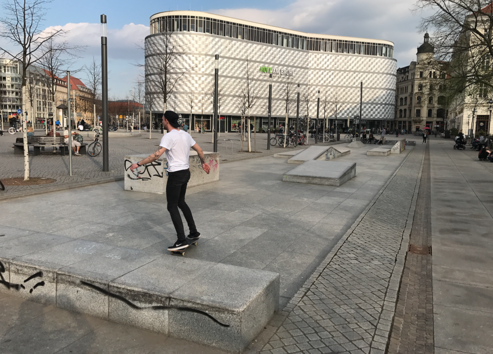 "In the foreground is the popular skatepark, which is combined with a small plaza that is used for markets and other events and in the background is the ""Tin Can"" shopping centre. This was one of the few times the area wasn't bustling with people."