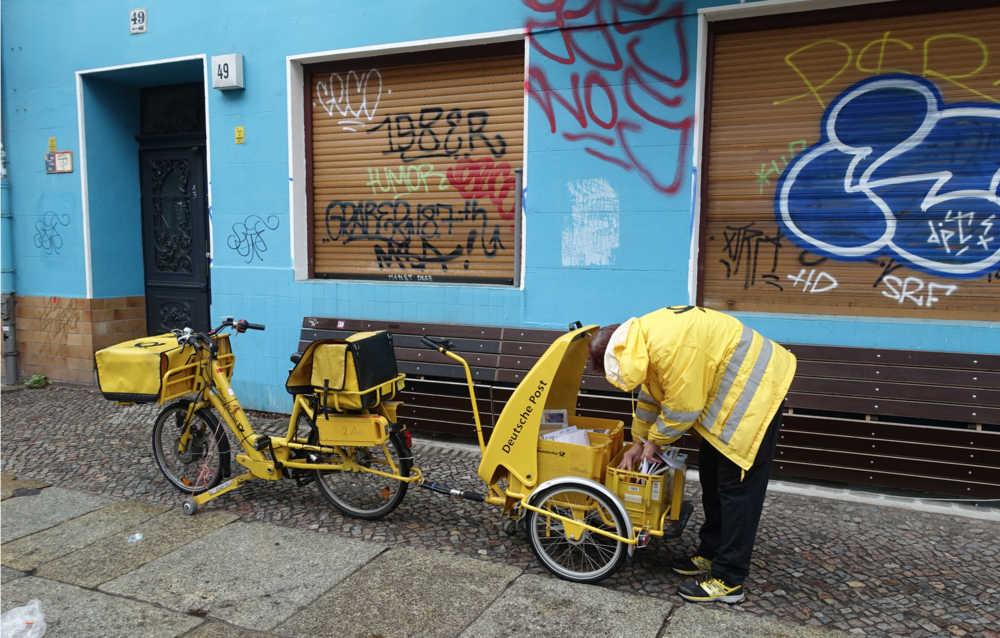 How about Berlin's mailpersons who ride these quirky yellow mail bikes along the sidewalk?