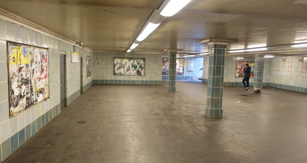 Loved this empty subway station space.  It seemed like an abandoned space, with unused advertising boards that have become transformed into works of art with their multiple layers of randomly ripped posters and graffiti. It had the appearance of a contemporary art gallery.