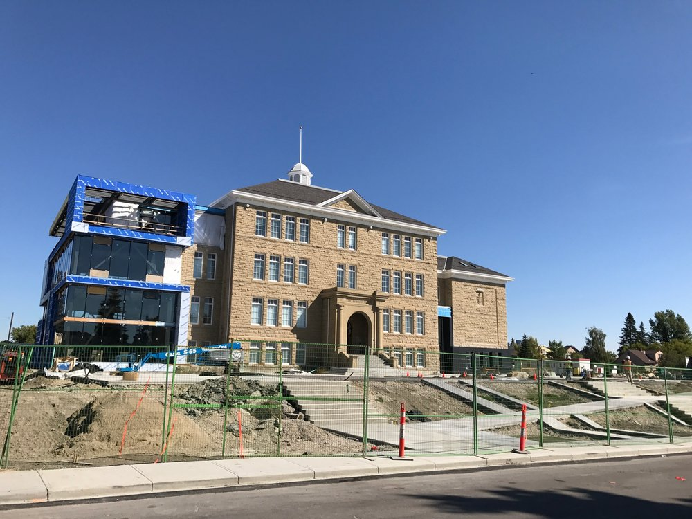 The majestic King Edward School is getting a new life as a creative hub.  The construction on the left side is the new performance space.  The site will also include luxury condos on the west side and a seniors complex on the east.