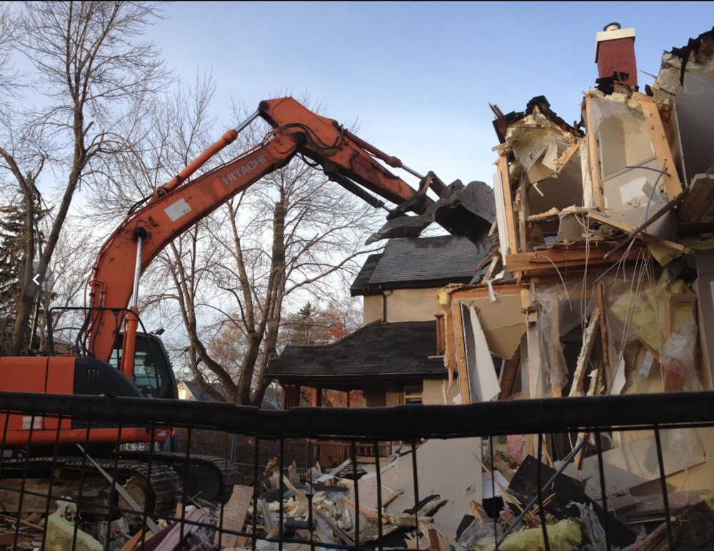 At almost two year's of age we watched together as a big toy demolished the housed next door.