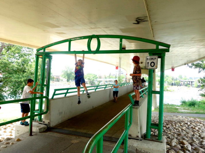 Calgarians of all ages love to test their strength and agility wherever and whenever they can.  This just happens to be under the LRT bridge linking downtown to Kensington Village.