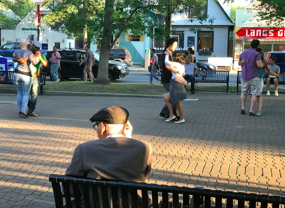 Impromptu couples dancing in Tomkins Park in RED (Retail, Entertainment District).