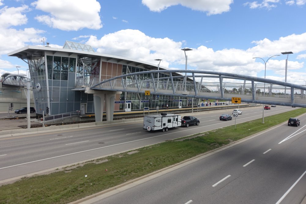 Many of Calgary's suburban LRT Stations are in the middle of a major highway, surrounded by Park & Ride lots, which makes for a long walk before you get to the neighbouring communities.