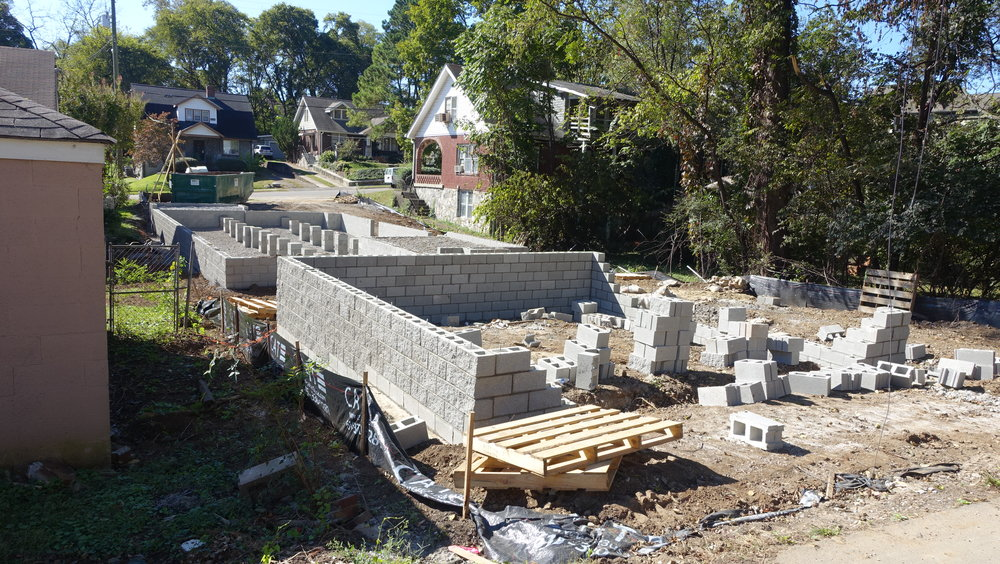 Construction of two houses on one lot, one at the front and one in the back.  Note there are no basements in most Nashville homes.