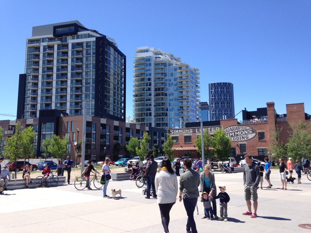 Calgary's East Village is a multi-billion dollar master-planned development  just to the east of the downtown core has a vibrant river walk plaza.