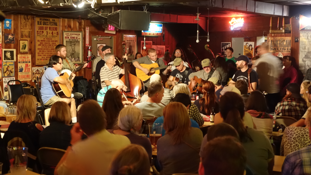 The Blue Grass Jam at the Gulch's iconic Station Inn live music venue is packed every Sunday night - standing room only.  Unfortunately, Calgary's King Eddy Hotel in East Village has been renovated, gentrified and sits empty most nights.
