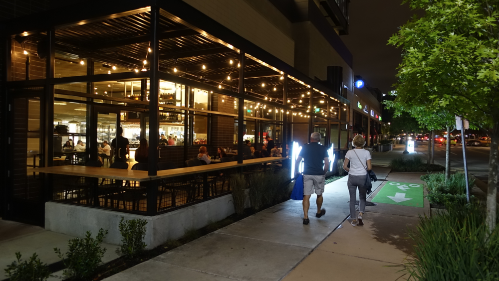 Nashville's Gulch District has several street patios creating an attractive pedestrian experience.
