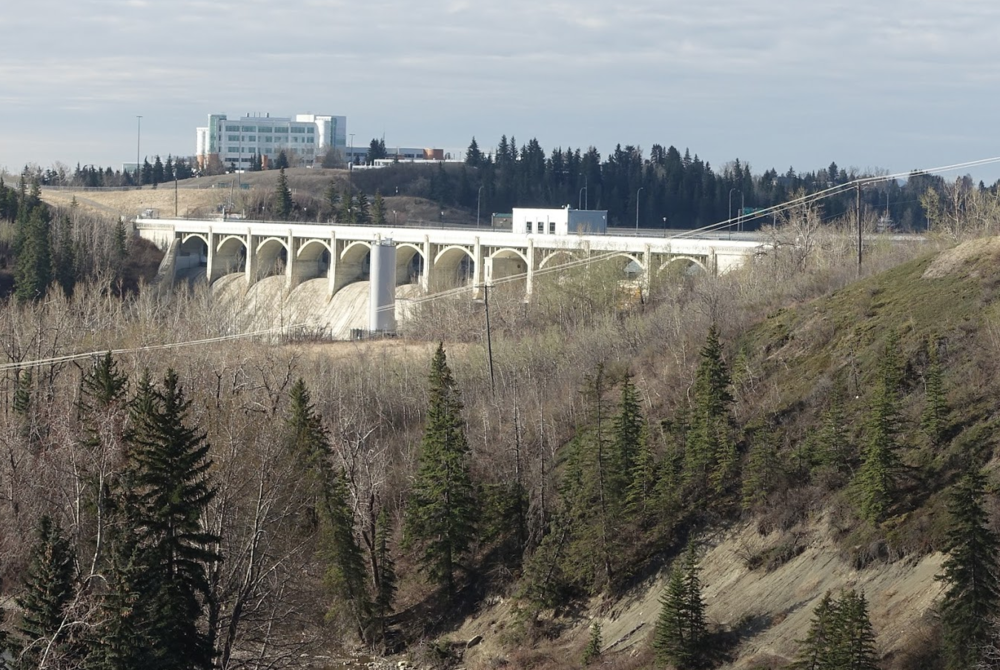 The Glenmore Dam built in 1932 also serves as a pedestrian bridge, with Sandy Beach on one side and the Glenmore Reservoir on the other.