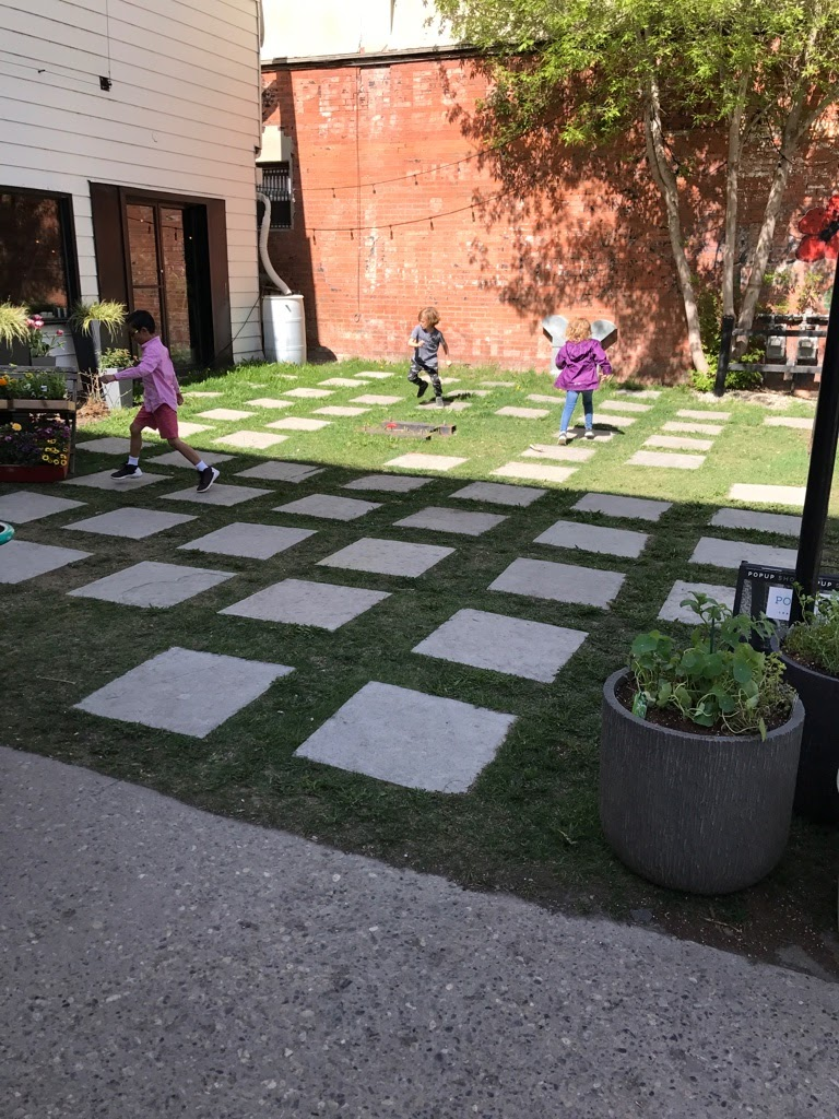 You know a neighbourhood is cool when you find kids playing on a mini plaza in front of retail store along its Main Street.    This is 9th Ave aka Atlantic Ave in Inglewood.