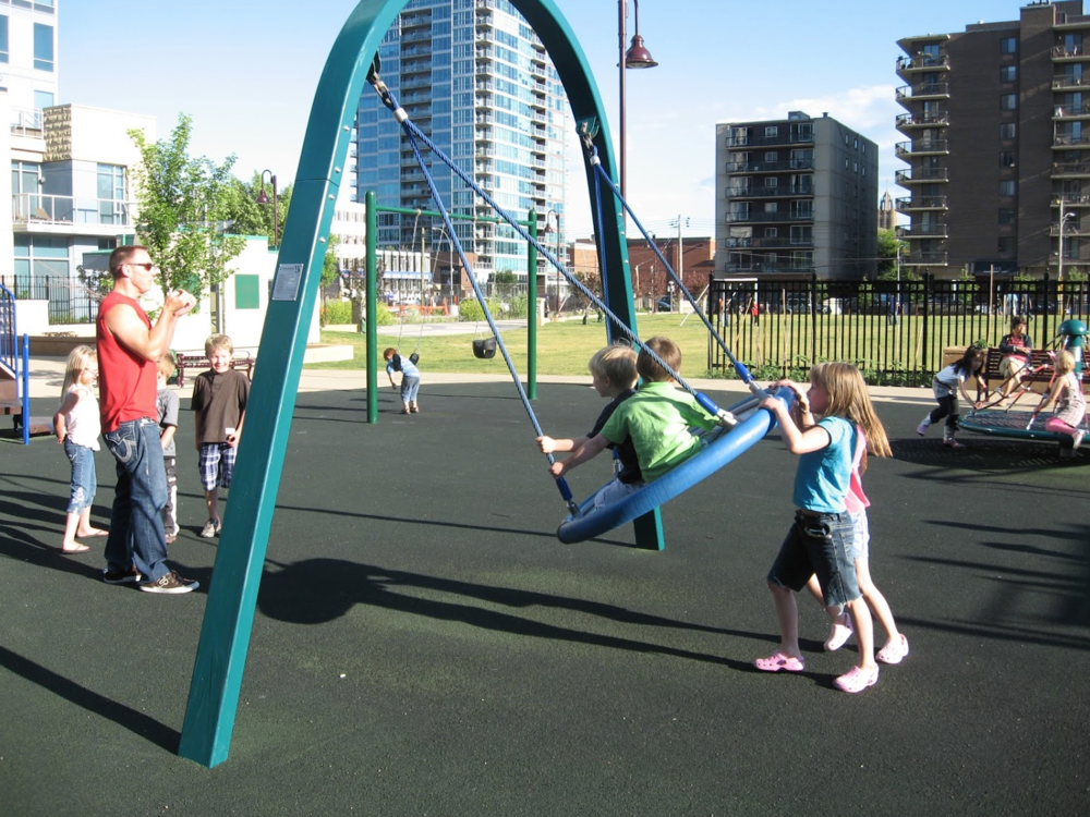 Who says families don't live in the City Centre. Haultain park's playground, playing field and tennis courts are well used by all ages.