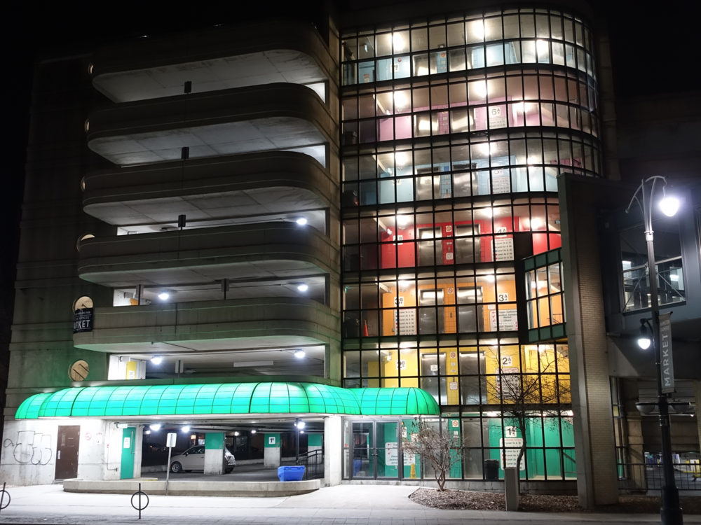 This brutalist parkade comes alive at night with light and colour.  How simple, effective and affordable is that.