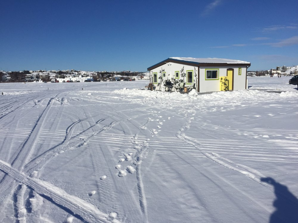 Living off the grid in a VRBO houseboat frozen into Great Slave Lake.
