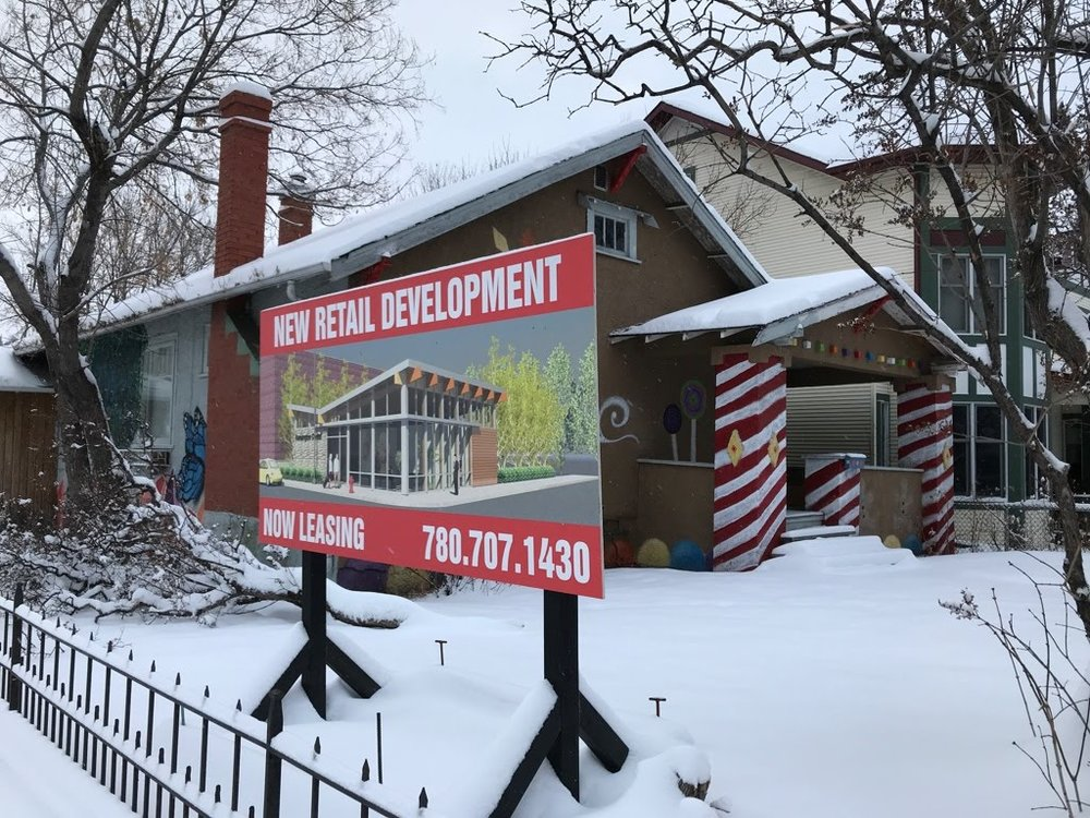 This fun house now has a development sign on the front yard.