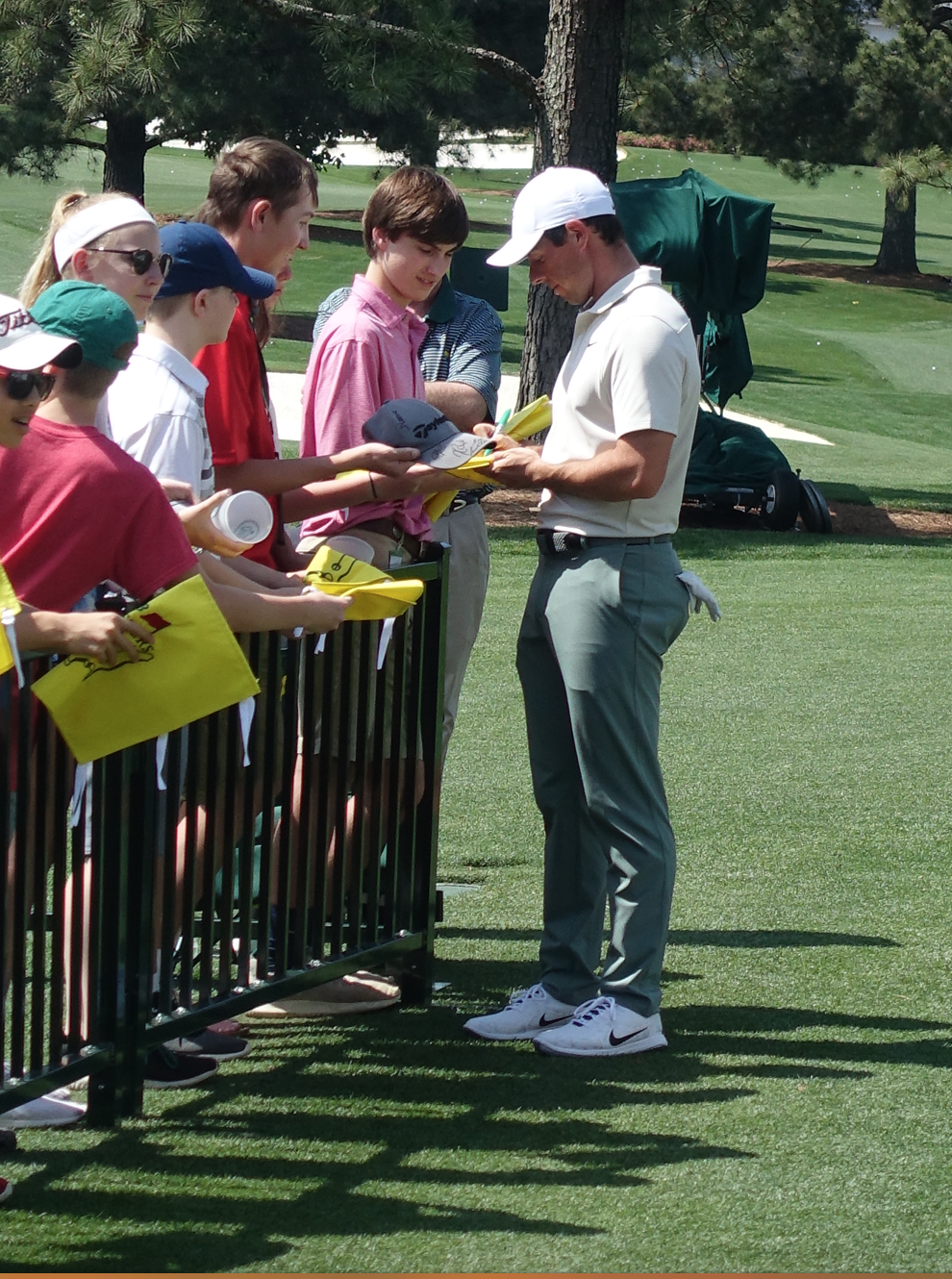 Rory McIlroy spent a long time signing autographs.