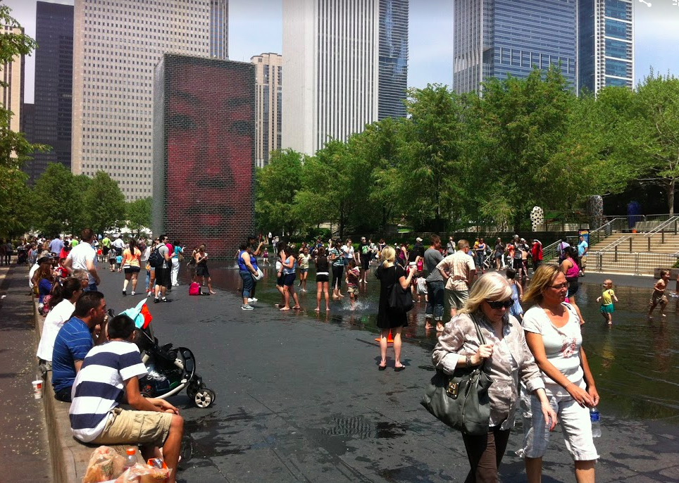 Crown Fountain in Chicago's Millennium Park attracts thousands of people of all ages to sit, play and splash.