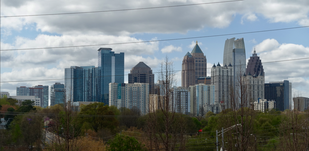 Atlanta's midtown skyline, with Piedmont Park in the foreground.