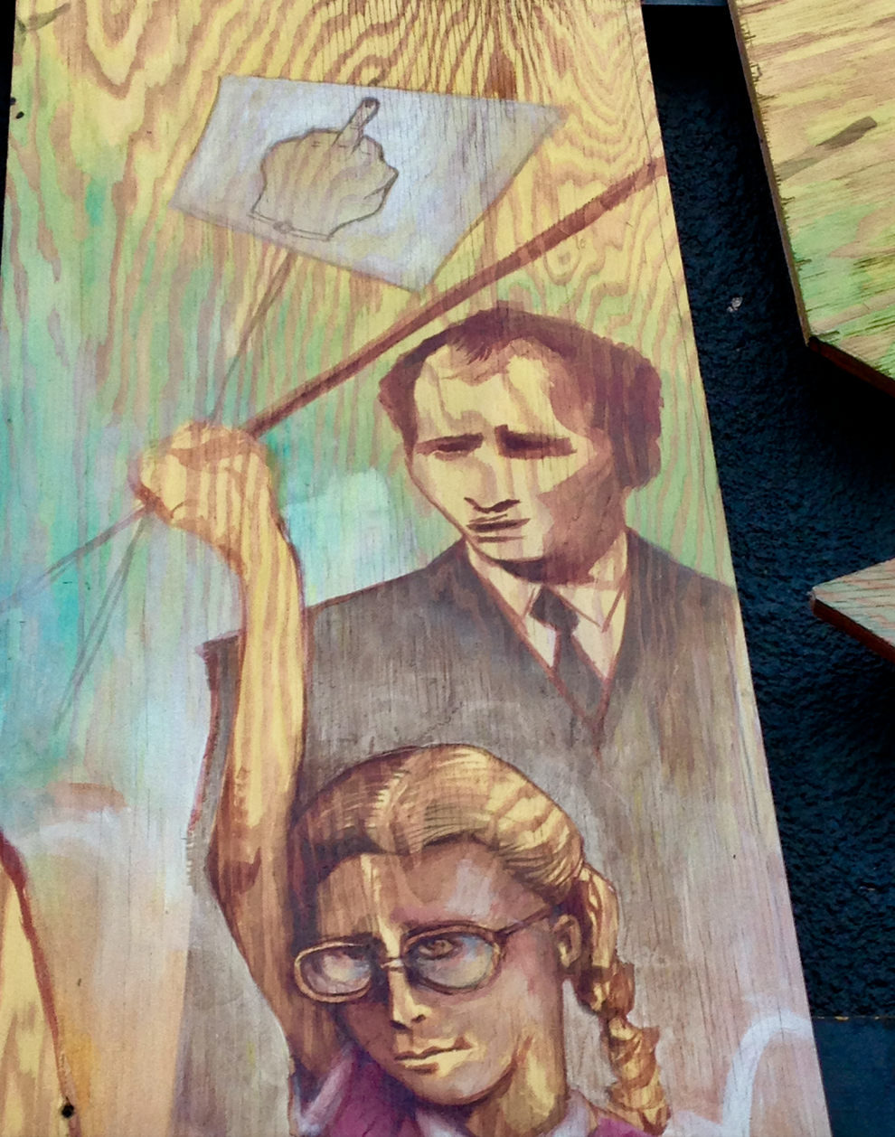 "On the side of the Hillhurst Sunnyside Community Association Building is a mural that has this young girl giving the ""finger' to Pierre Trudeau.  Backstory: Back in 1982, then Prime Minister of Canada, Trudeau flipped the finger to protesters in Salmon Arm BC. It soon became known as the ""Trudeau Salute."" I am thinking many Calgarians would love to flip the finger these days to his son, Justin, who is now the Prime Minister."