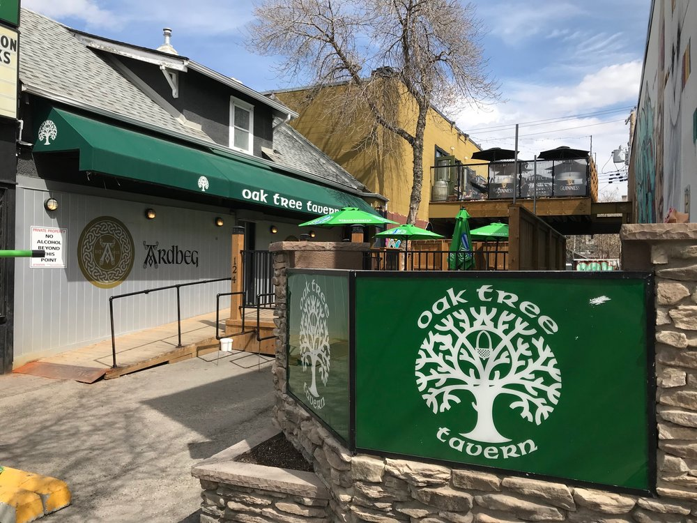 The Oak Tree Tavern welcomes thirty pedestrians to drop in for a beverage. The patio offers great views of the downtown skyline.